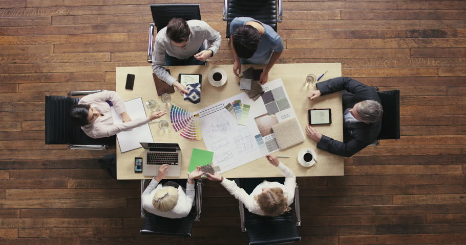 Top View of Business people meeting around boardroom table discussing textiles for new sustainable shared office space | Shutterstock HD Video #12707156
