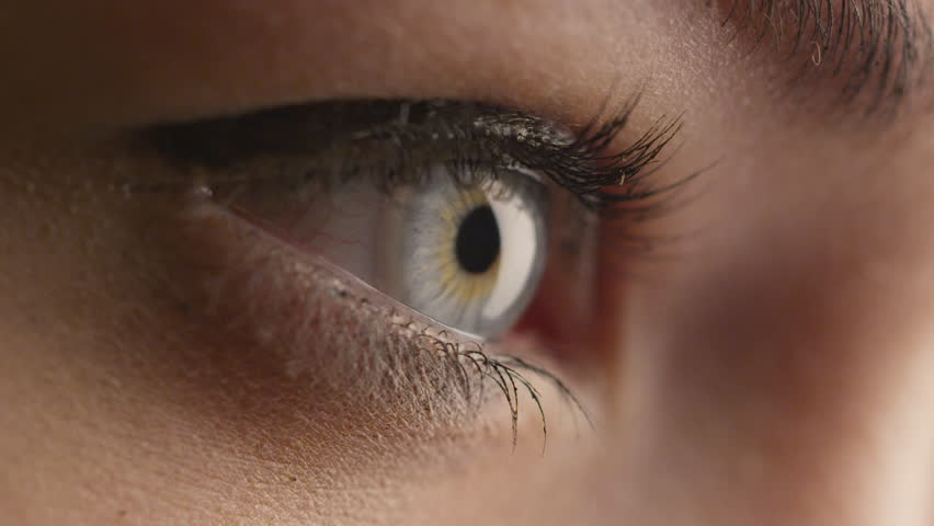 Close-up shot of woman opening her blue eyes and focusing her sight. Shot on RED Cinema Camera in 4K (UHD)