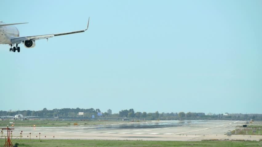 Commercial Airliner Landing. Aircraft landing at Barcelona Airport. Passenger airplane landing. Aircraft landing at Barcelona Airport. Passenger airplane landing. Flying airplane approaching airstrip