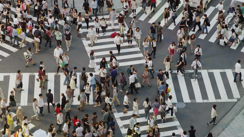 JAPAN-TOKYO, JUNE. 30, 2012: Shoppers on a Cross Street Crossing in Shinjuku, Tokyo, Slow Motion