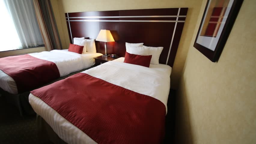 Two Beds With White Linens Stock Footage Video 100 Royalty Free 12742202 Shutterstock