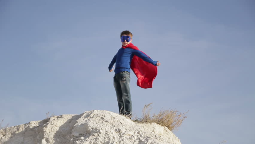 Superhero boy  runs through the mountains and trying to fly | Shutterstock HD Video #12750872