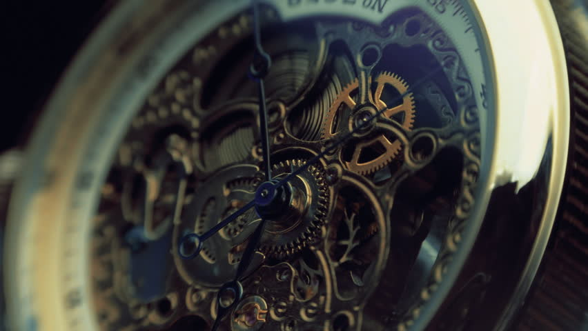 The mechanism of a wristwatch antique style. The camera moves around. Closeup. Shallow depth of field