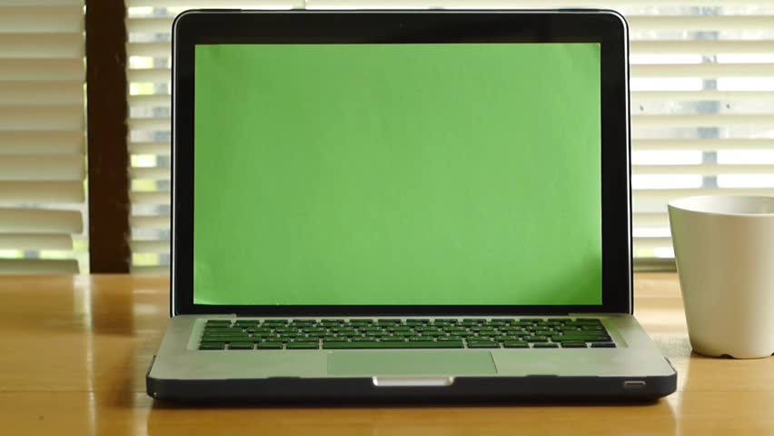 Dolly shot - Laptop computer notebook with green screen monitor   Shutterstock HD Video #12758597