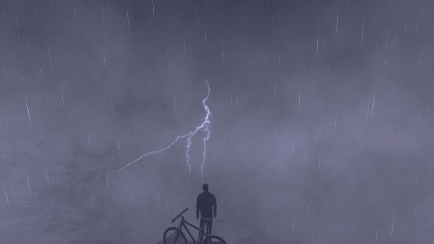 Cyclist on top of the mountain, storm with lightning, tilt