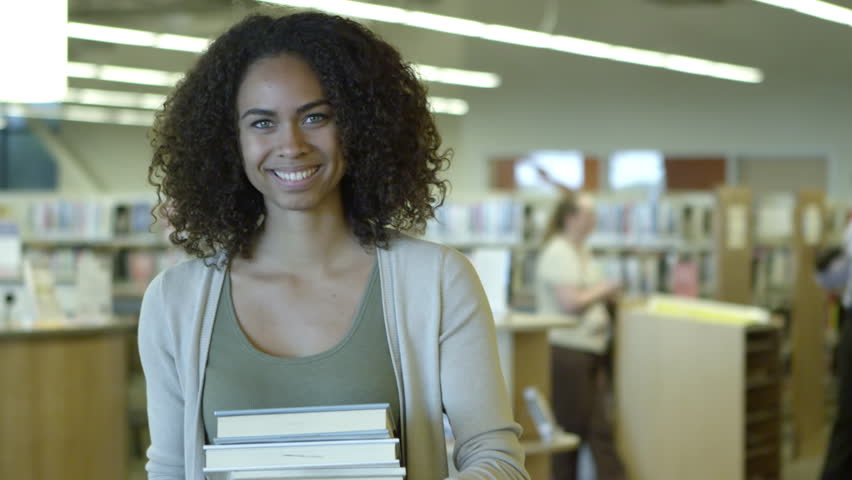 Portrait of female studying with library books #12813617