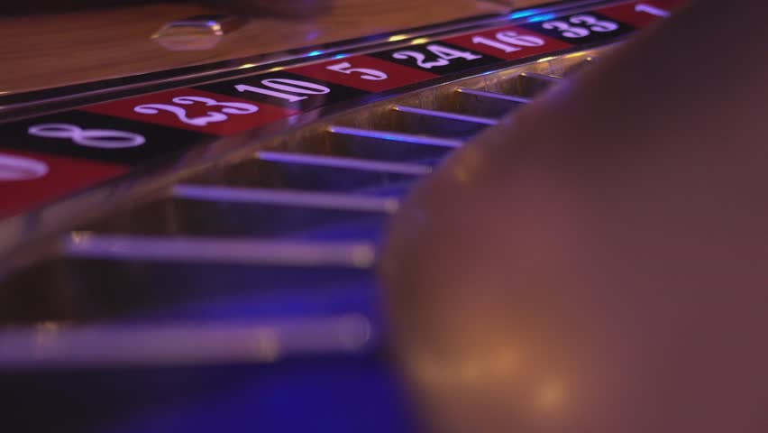 Macro view on a Roulette Wheel in a casino - ball falls in field 5 red   Shutterstock HD Video #12838136