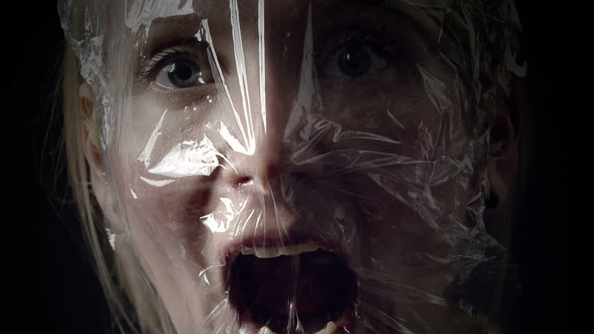 Young Woman Comparing a Panic Attack to Suffocating into a Plastic Bag