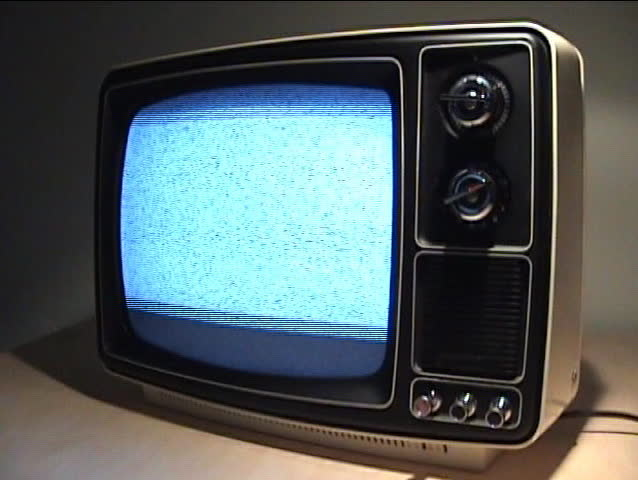 Angle shot of an old B&W TV without reception signal | Shutterstock HD Video #128491