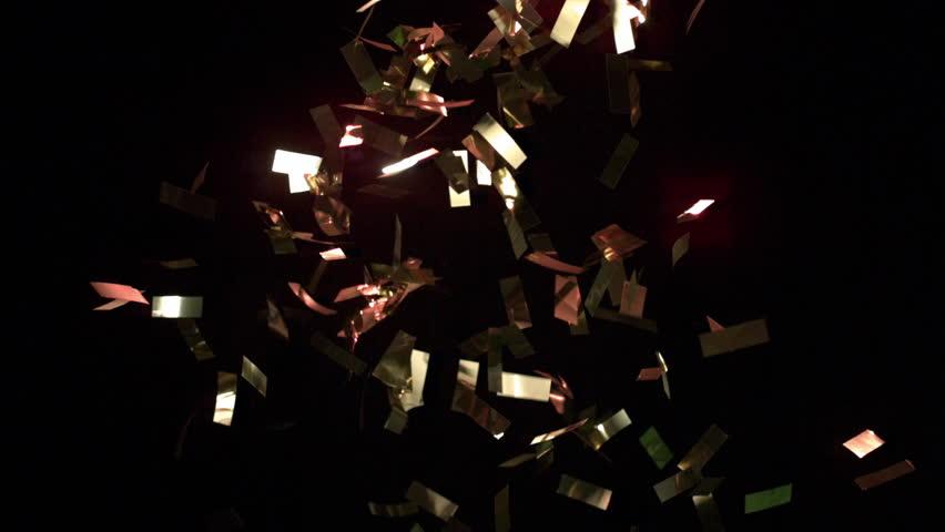 Confetti exploding into the air. | Shutterstock HD Video #12850946