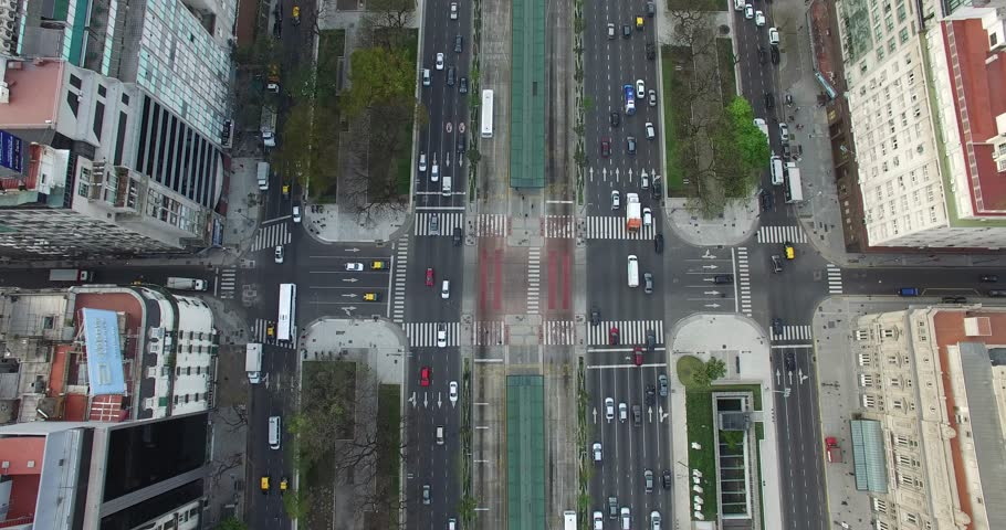 Aerial Drone scene of  9 de Julio main Avenue, 9 of july Avenue in Buenos Aires, Argentina. Traffic and people going to work.  | Shutterstock HD Video #12874028