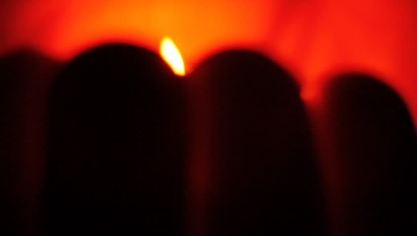 Small tea candle in palm hand, between fingers. Extreme macro clip. | Shutterstock HD Video #12880412