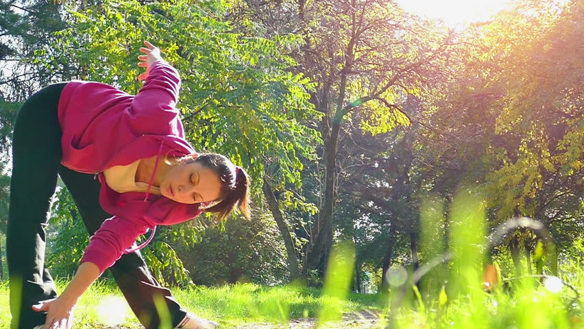 A young woman doing exercise in nature, Slow Motion of Exercise in a Nature, Slow Motion Video Clip | Shutterstock HD Video #12881924
