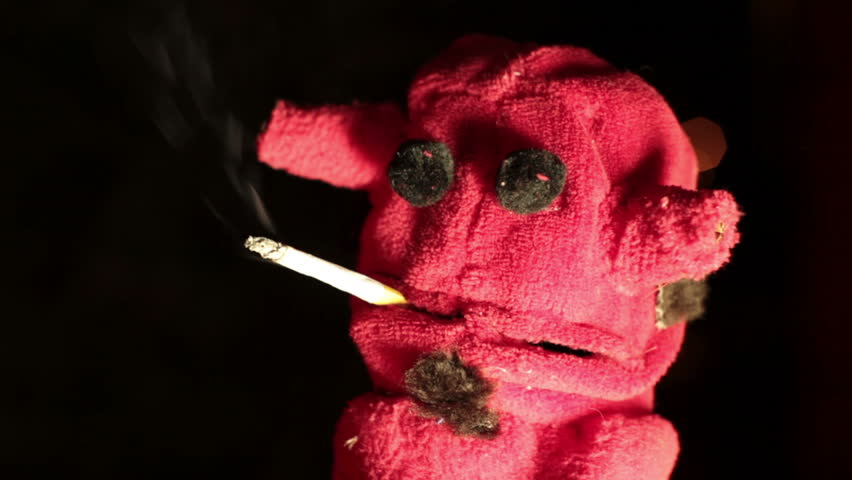 Devil Puppet Smoking a Cigarette. Stock Footage Video (100 ...