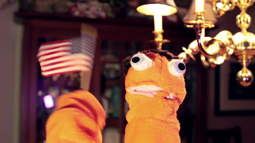Puppet holding an american flag