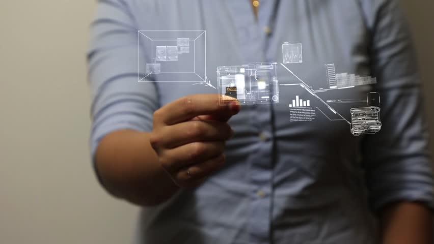 Hand holds mini sd card | Shutterstock HD Video #12900692
