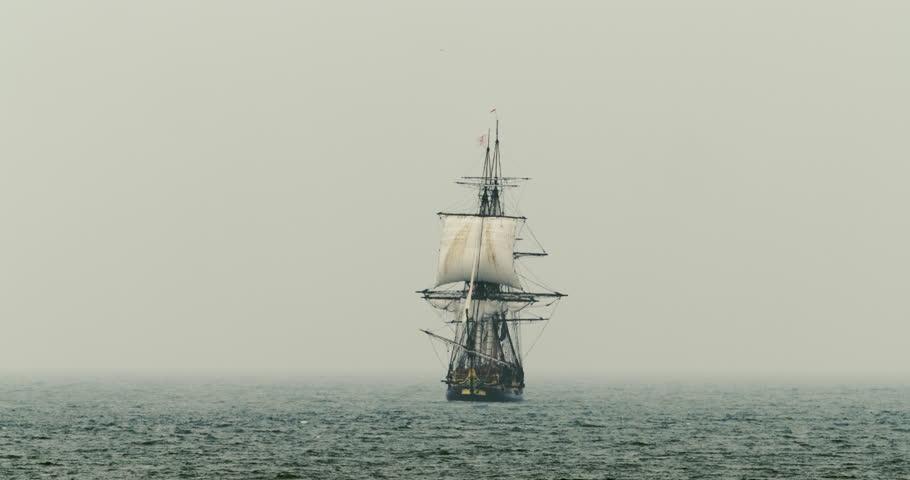 A tall ship schooner sails on the high seas in misty fog. #12900872