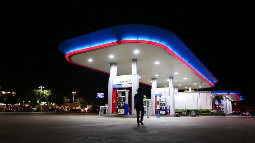 CHONBURI,THAILAND- NOVEMBER 20, 2015: Time lapse of PTT gas station with vehicle on night time at high way road during Chonburi city to Bangkok city , Chonburi ,Thailand   Shutterstock HD Video #12919667