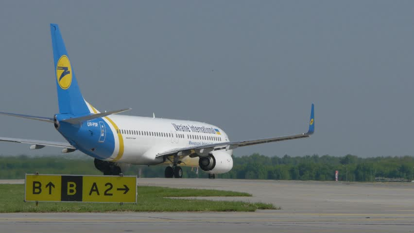 KIEV - MAY 20: Long shot of Boeing 737-800 aircraft taxiing to the runway, tail view at Boryspil International Airport on May 20, 2015 in Kiev, Ukraine.