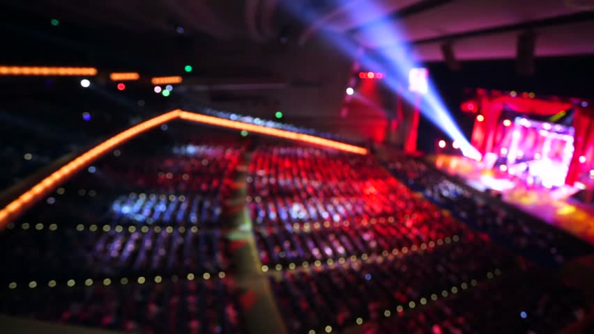 Live concert inside a huge hall, out of focus background. | Shutterstock HD Video #12928094