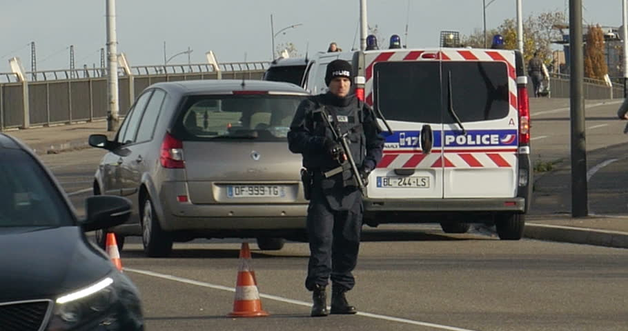 STRASBOURG, FRANCE - NOV 14 2015: French Police with machine gun checking vehicles on the 'Bridge of Europe' between Strasbourg and Kehl Germany, as a security measure in the wake of attacks in Paris