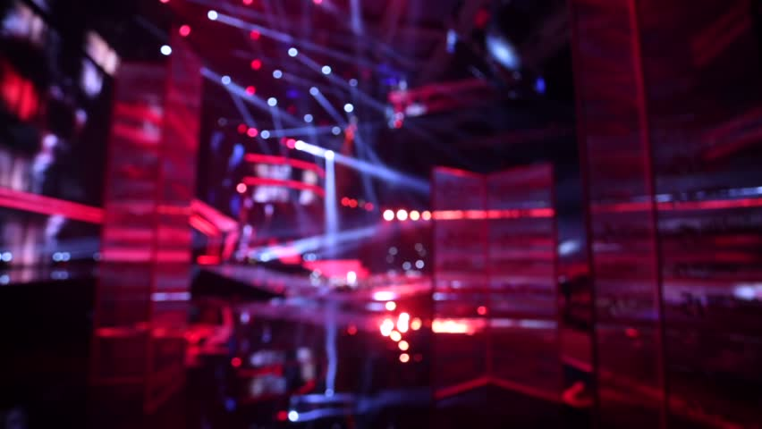 Defocused view, leading goes out onto a concert stage. | Shutterstock HD Video #12958307