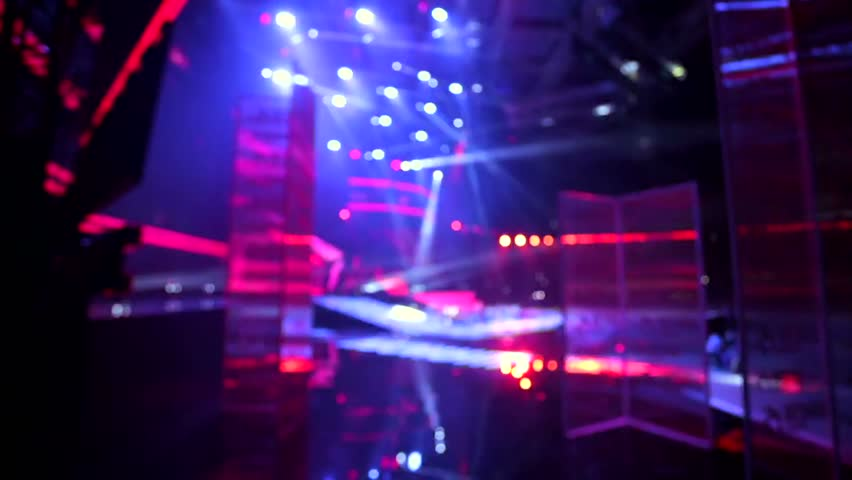 Defocused view, bright stage lights flashing. | Shutterstock HD Video #12958331