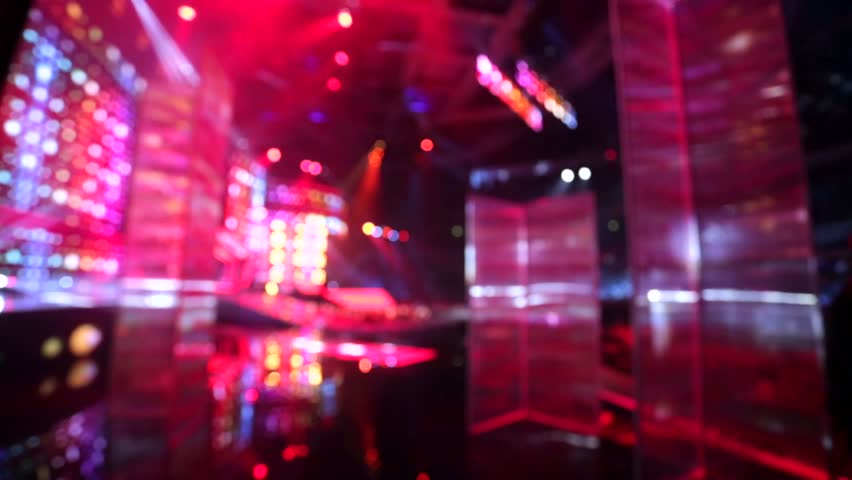 Defocused view, bright stage lights flashing. | Shutterstock HD Video #12958334