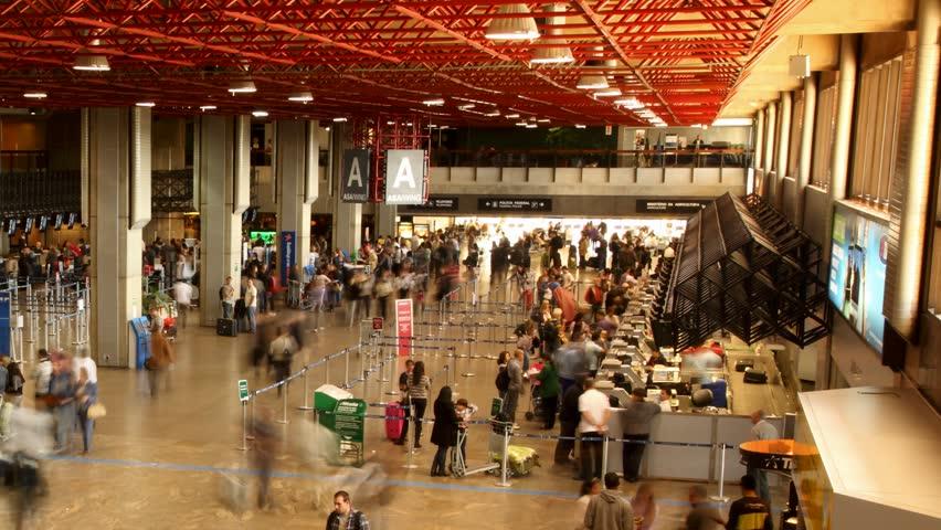 SAO PAULO, BRAZIL - JUNE 26: Passengers and world travelers check in at Guarulhos Airport, Sao Paulo Brazil June 26 2011. Guarulhos is the main airport serving São Paulo, Brazil.