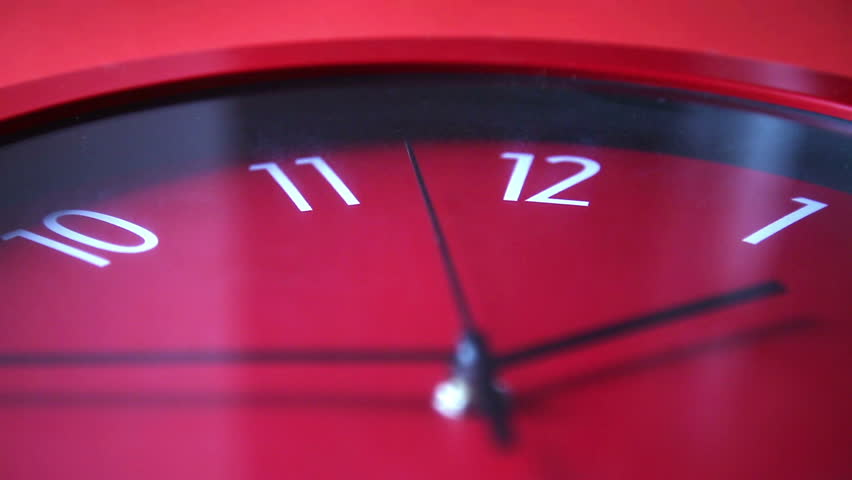 red wall clock workingand rewinding #12978992