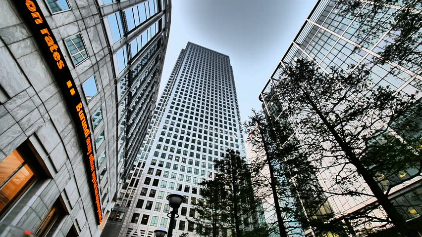 LONDON, UK - 13 MAY 2015: A low, wide angle view of the prominent Docklands landmarks of Canary Wharf and the Reuters Building in the heart of London's prime business district.   Shutterstock HD Video #13005899
