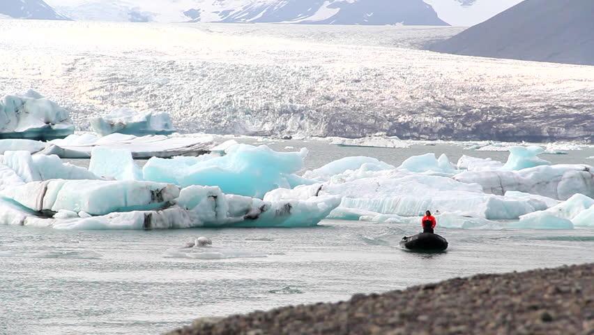raft boat sailing in icebergs lagoon