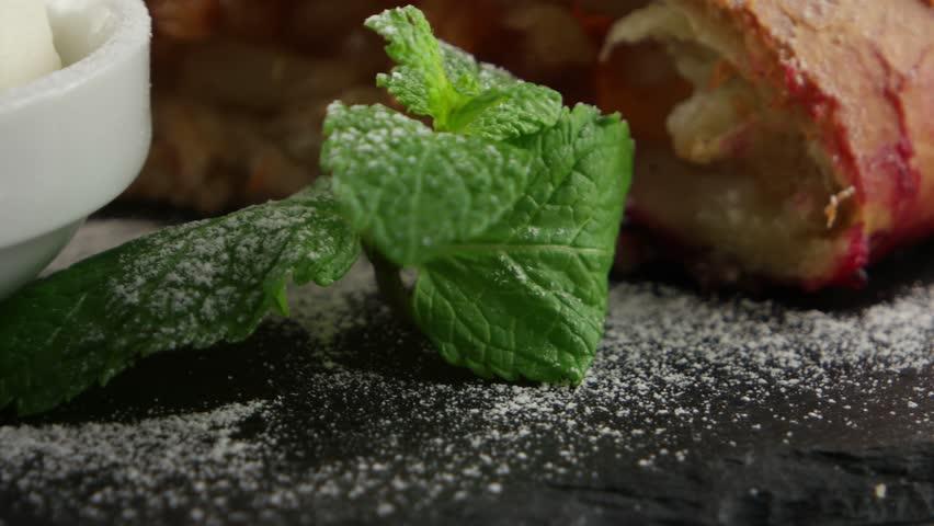 Apple pie (vienna strudel) with ice cream on black slate tray