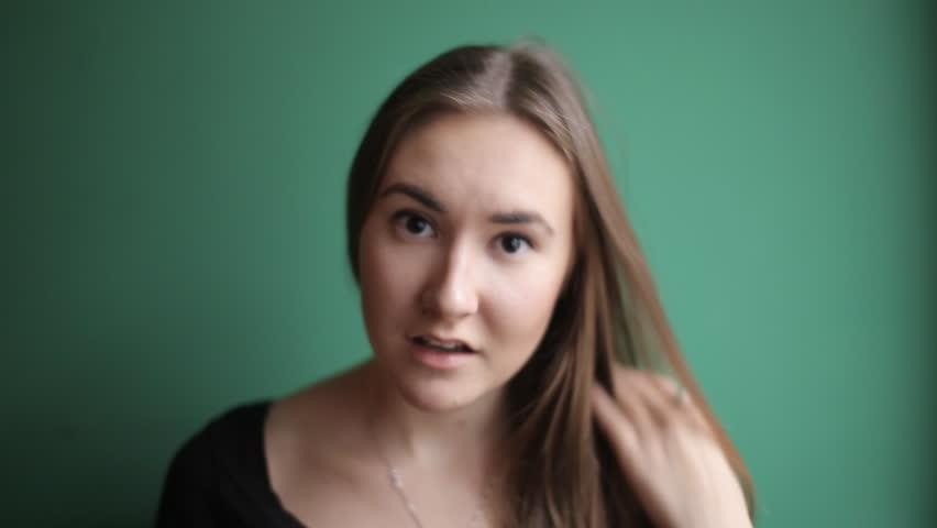 Beautiful girl making faces | Shutterstock HD Video #13042193
