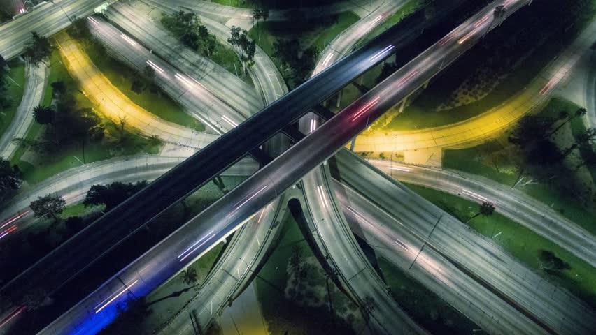Vertical aerial view of traffic on freeway interchange at night. 4K UHD timelapse.   Shutterstock HD Video #13043018