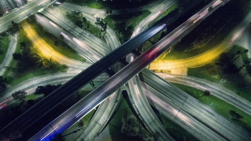 Vertical top down aerial view of traffic on freeway interchange at night. 4K UHD timelapse.   Shutterstock HD Video #13043030
