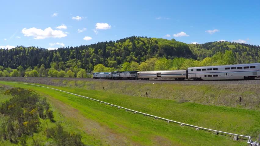 OREGON - CIRCA 2015 - An aerial view following an Amtrak passenger train.