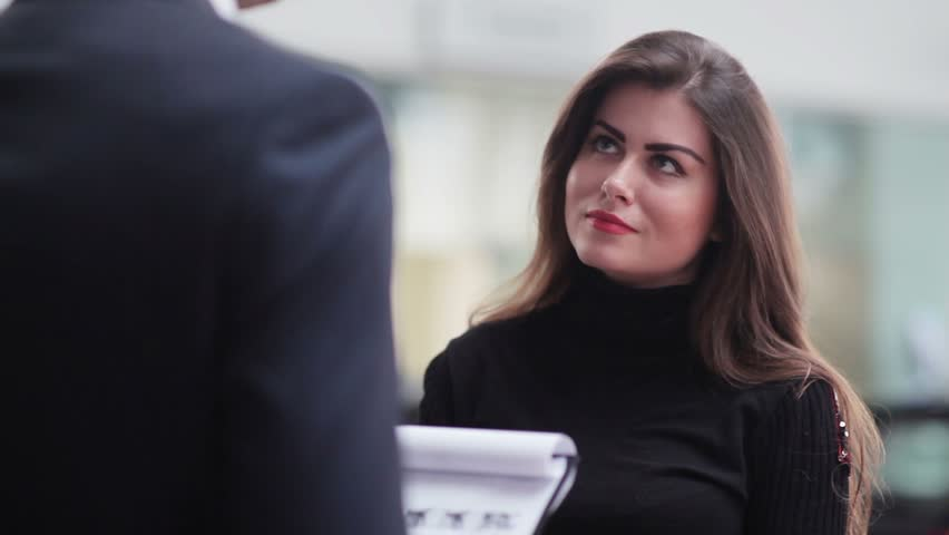 Beautiful girl listens attentively to contract terms in car dealership | Shutterstock HD Video #13069643