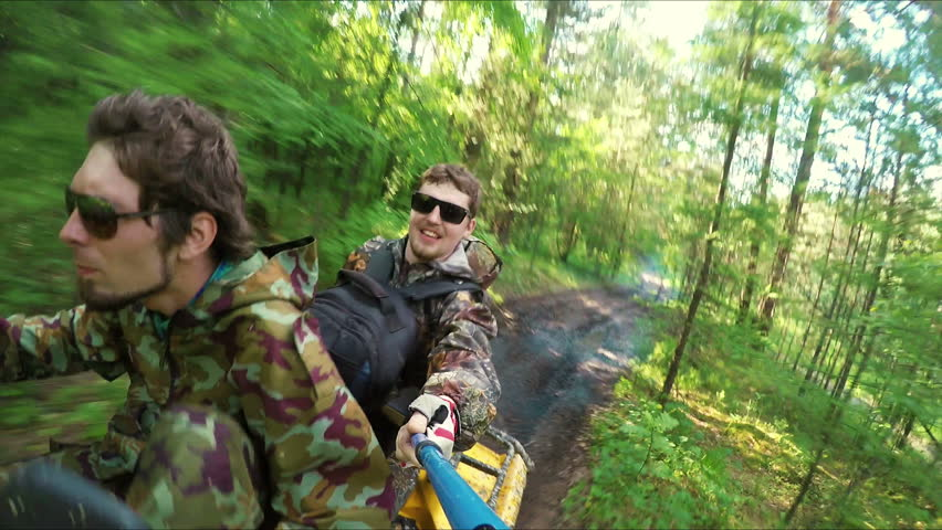 Two Man on ATV in a forest video Selfe