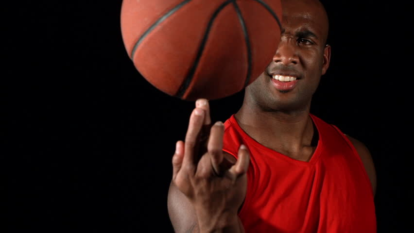 Cinemagraph - Basketball player spins ball on finger, slow motion. Looping Motion Photo.