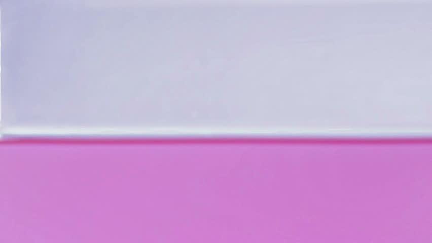 Slow motion droplets splashing in pink water   Shutterstock HD Video #13102304