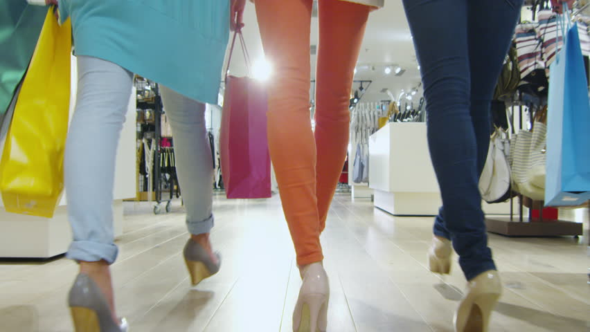 Low shot of three girls that are walking through a clothing store in colorful garments. Shot on RED Cinema Camera in 4K (UHD). | Shutterstock HD Video #13108010