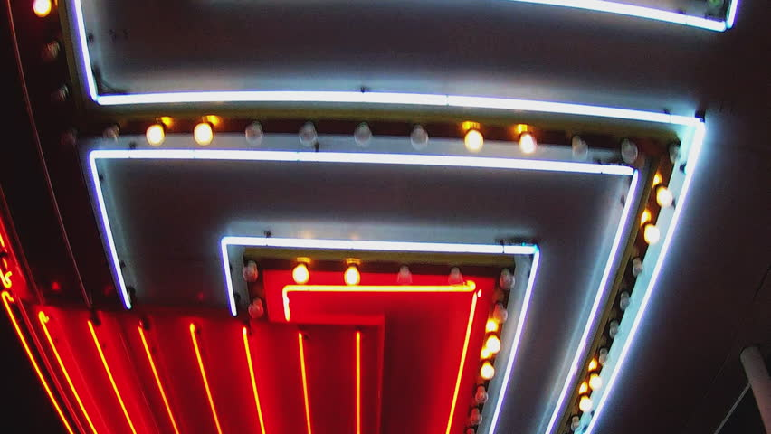 Low angle shot looking up while walking under bright casino lights on Fremont Street in Las Vegas Nevada. Generic neon tubes of light pass by overhead.    Shutterstock HD Video #13118750