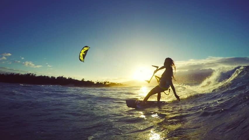 Extreme Kitesurfing at Sunset. Summer Ocean Sport in Slow Motion. Girl Kite Surfing in Bikini | Shutterstock HD Video #13139489