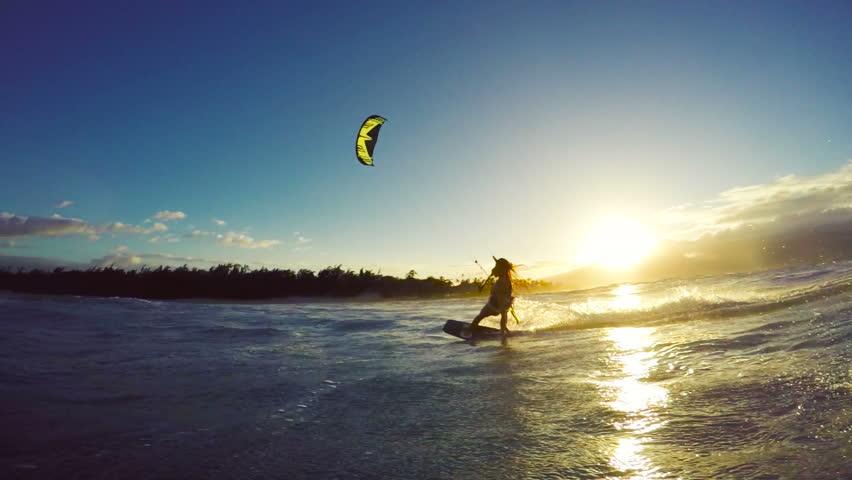 Extreme Kitesurfing down Big Ocean Wave at Sunset. Summer Ocean Sport in Slow Motion. Girl Kite Surfing in Bikini #13139570