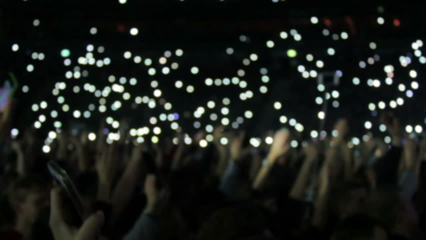 People light fires on their phones at a concert. defocused footage | Shutterstock HD Video #13163879