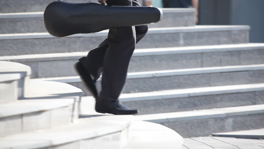 Violinist goes down and climbs the stairs | Shutterstock HD Video #1317703