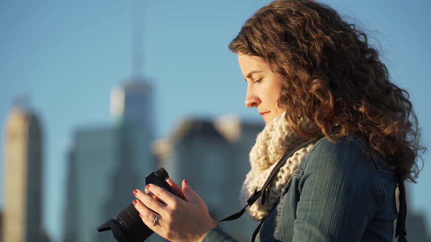 A woman takes pictures of NYC skyline. LD | Shutterstock HD Video #13207466