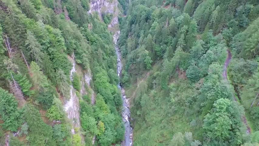 Flight over a river valley in the alps  | Shutterstock HD Video #13224941