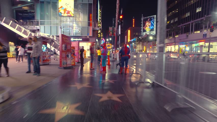 HOLLYWOOD, CA - December 9, 2015: Hectic POV walk on Hollywood Blvd Walk of Fame at night. 4K UHD Timelapse hyperlapse view. #13229552